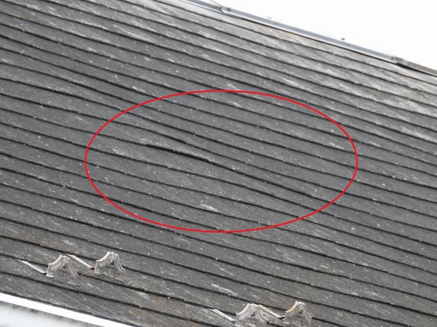 築32年のスレート屋根変形